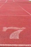 Numret som används för idrottsman nen Arkivfoto