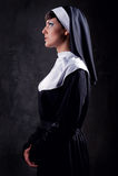 Nun. Young attractive pensive nun indoors royalty free stock photo