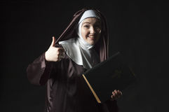 Nun advertises bible Stock Images