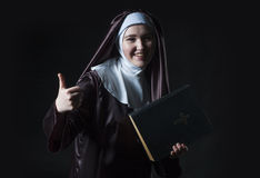 Nun advertises bible Stock Photo