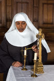 Nun and altar Royalty Free Stock Images