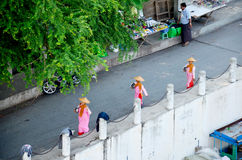 Nun or ascetic women walking on the road Royalty Free Stock Images