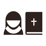 Nun and bible icon Stock Photography