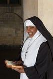 Nun with bible stock photos