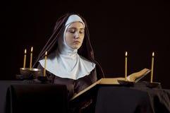 Nun with bible. Stock Image