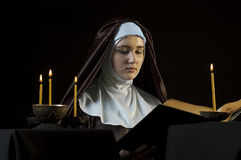 Nun with bible. Royalty Free Stock Images