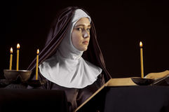 Nun with bible. Royalty Free Stock Image