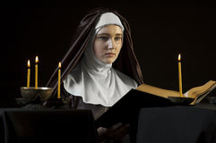 Nun with bible. Royalty Free Stock Photography