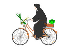 The nun on a bicycle. Royalty Free Stock Image