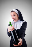 Nun with bottle of red wine Stock Image