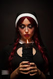 Nun with a candle in hands Stock Photo