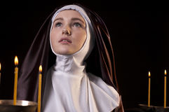 Nun with candles. Royalty Free Stock Photo