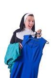 Nun choosing clothing on the hanger Stock Photography