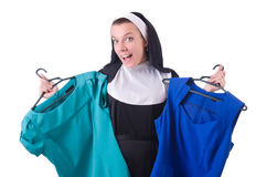 Nun choosing clothing on the hanger Royalty Free Stock Photos