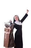 Nun choosing clothing on the hanger Stock Image