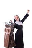 Nun choosing clothing on the hanger Stock Image