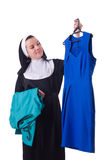 Nun choosing clothing on the hanger isolated Royalty Free Stock Photos