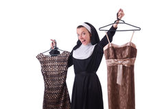 Nun choosing clothing on the hanger isolated Stock Photo