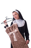 Nun choosing clothing on the hanger isolated Royalty Free Stock Images