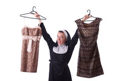 Nun choosing clothing on the hanger isolated Stock Photography