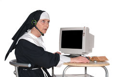 Nun on computer Royalty Free Stock Image