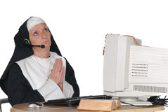 Nun on computer Stock Photos