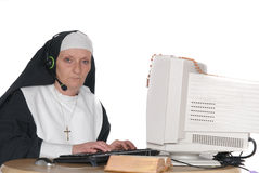Nun on computer Royalty Free Stock Photography