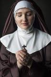 Nun with cross Stock Photo