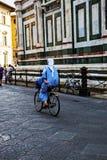 Nun cycling near the Florence Duomo Royalty Free Stock Photos