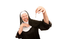Nun disgusted by cigarette Stock Photography