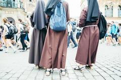 Nun feet in crowd Stock Photo