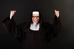 Nun with fists clenched Stock Photos