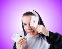 Nun in the gambling concept Stock Photos