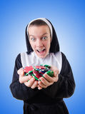 Nun in the gambling concept Stock Images