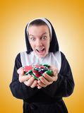 Nun in the gambling concept Stock Image