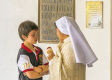 Nun Giving Comfort to a Child Royalty Free Stock Images