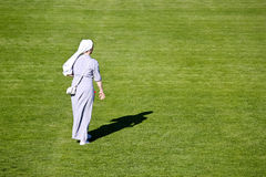 Nun on green soccer field Royalty Free Stock Photo