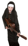 Nun With Guitar. Funny nun sings a song while playing her guitar royalty free stock images