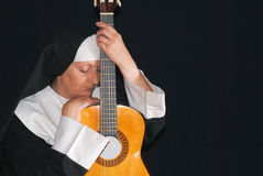 Nun with  guitar Stock Image