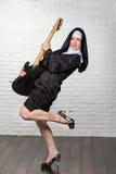 Nun with a guitar Stock Photos