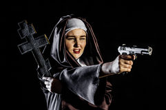Nun with gun and cross Royalty Free Stock Images