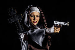 Nun with gun and cross Stock Images