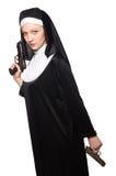 Nun with gun isolated on white Royalty Free Stock Photos