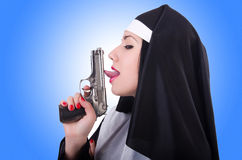 Nun with gun  Stock Photo