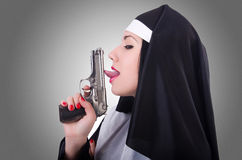 Nun with gun  Stock Images