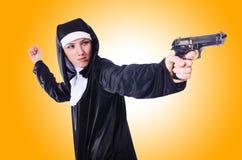 Nun with handgun isolated Royalty Free Stock Image