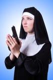 Nun with handgun  Stock Photography