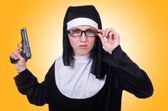 Nun with handgun  Royalty Free Stock Photos