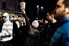 Nun holding bible during protest. Nun holding bible joining a mass protest in Bucharest University square. Protests continue after PM resigns, people are asking Royalty Free Stock Photo