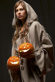 Nun holding halloween pumpkins Royalty Free Stock Photo